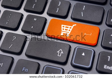 online shopping or internet shop concepts, with shopping cart symbol. - stock photo