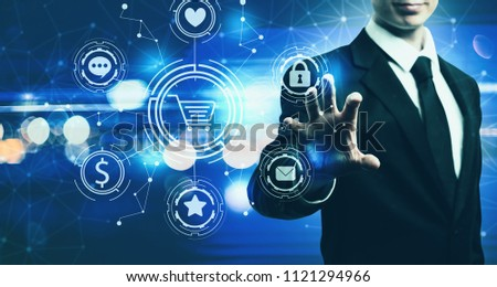 Online Shopping Theme with businessman on blurred blue light background #1121294966