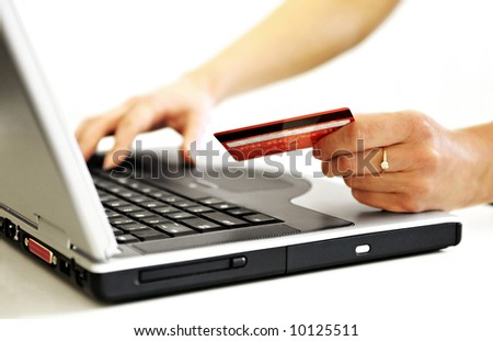 Online Shopping. Very shallow DOF! Focus on the hand and on the card.