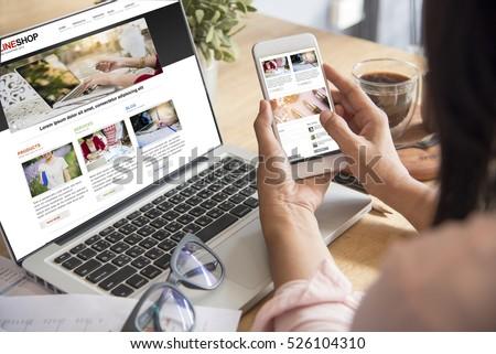Online Shopping Website on Laptop. Easy E-commerce Website Shop Online by Smartphone, iPhone, iPad and Laptop. Hands Using Smartphone Shopping Cart Reading Online Article, Blog.