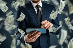 Online sports betting. A man in a suit is holding a smartphone and dollars are falling from the sky. Creative background, gambling