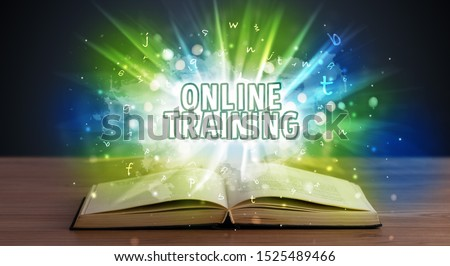 ONLINE TRAINING inscription coming out from an open book, educational concept