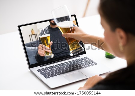 Online Virtual Beer Drinking Party On Laptop