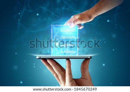 Online voting, Hand with a hologram ballot and a box for Internet voting in a mobile phone on a blue background. Mixed environment, e-voting technology concept Сток-фото ©