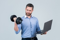 Online work gym that helps spur productivity. Manager hold laptop curling dumbbell. Strength training. Business coach. Fitness at work. Weightlifting workout. Workplace gym. Technology in sport.