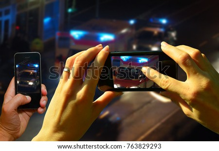 Onlookers film an accident scene with the cell phones Stock fotó ©