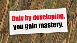 Only by developing, you gain mastery. Text inscription in the banner plate. An irreversible, natural change. Transition from the old quality to the new one.