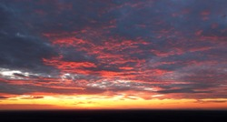 Only sky at sunset, abstract view with red and orange clouds
