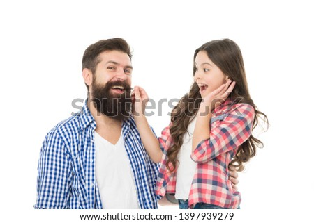 Only the best man can grow a beard. Little daughter touching beard of her father. Bearded man with long beard hair and small girl child. Trimming thick beard at barbershop.