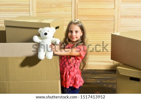 Only true friend. Girl child play with toy near boxes. Move out concept. Packaging things. Stressful situation. Divorce and separation. Family problem. Prepare for moving. Moving out. Moving routine. #1517413952