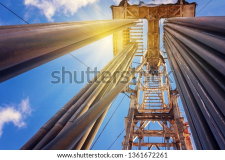 Onshore land rig in oil and gas industry. Oil drilling rig against a blue sky with clouds