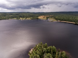 Ontario Canada contryside nature Aerial view looking down from above of river flowing inside lake