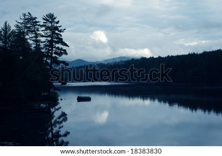 Ontario, Canada - July 28, 2008: Photo of small cold Canadian lake in the evening.