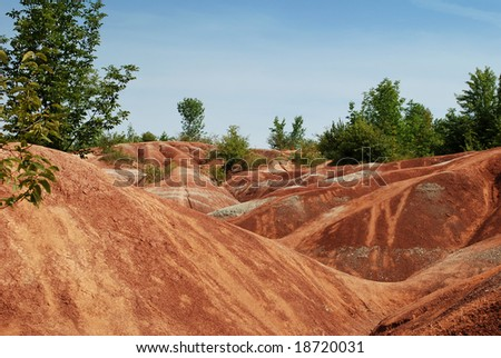 Ontario, Canada - September 14, 2008: Exotic Landscape of  the Cheltenham badlands surrounded by a forest. It is the popular hiking and biking place in Ontario, Canada