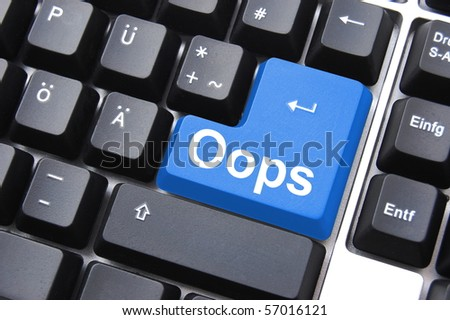 oops button on computer keyboard showing error or mistake concept