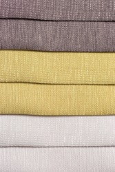 Opaque soft tones of brown, yellow gold and off white interior decoration sample color swaps of textured curtain fabric for comparison and feel