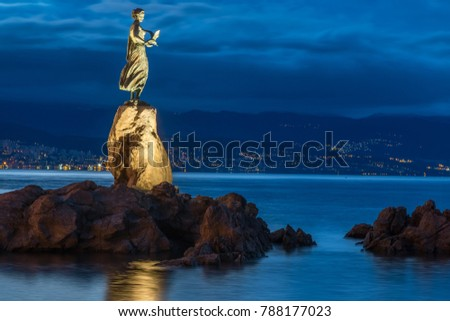 OPATIJA, CROATIA - JANUARY 2nd 2018: Maiden with the Seagull Statue, the famous landmark of Opatija in the morning.