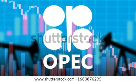 OPEC logo. Inscription OPEC on the background of falling charts. Concept - cheaper oil due to export growth. The failure of the OPEC negotiations led to a drop in oil prices. Silhouettes of oil pumps Stockfoto ©