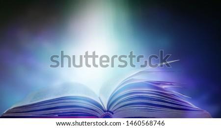 Open a magical magic book with a dark background. #1460568746