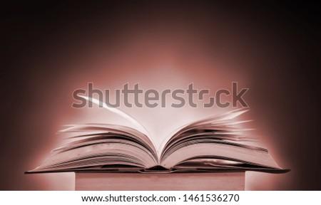 Open a magical magic book with a dark background. #1461536270