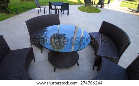 Open-air cafe furniture, wicker chairs and table