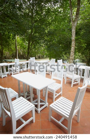 Open air cafe tables and chairs in rain forest