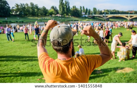 Open air concert. City day. Music festival. Entertainment concept. Visit summer festival. Guy celebrate holiday or festival. Summer fest. Man bearded hipster in front of crowd. Book ticket now.