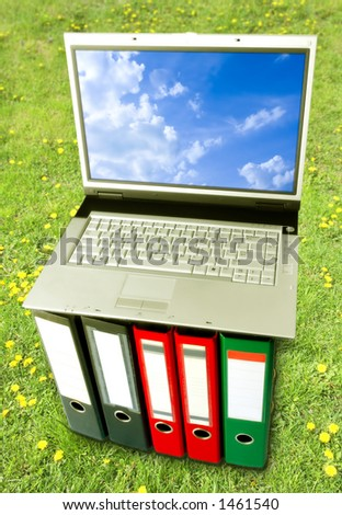 Open Air Digital Arrangement (Laptop On Binders Over Green Grass Background)