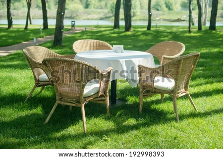 Open air restaurant with wood chairs in the forest