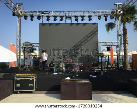 Open air show stage set up with led screen, sound and light system. Back line with drums. Horizontal image Stockfoto ©