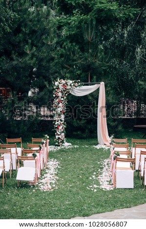 Free photos wedding ceremony wedding decorationswedding archway open air wedding ceremony with wedding arch decorated with flowers and white fabric wooden chairs junglespirit Choice Image