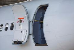 open aircraft door, door on repair, aircraft repair