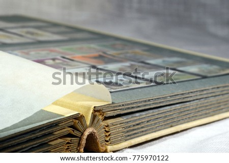 Open album with sets of postage stamps #775970122