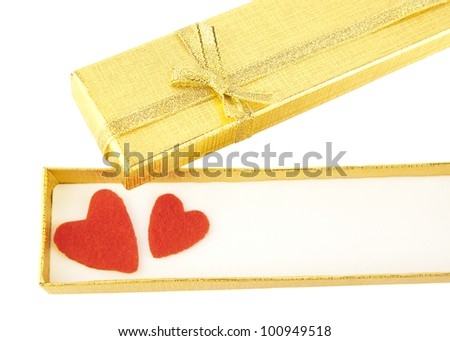 Open an empty box with a gold a ribbon with two red hearts on the inside of an isolated white background