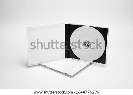Open and close compact plastic disc box case set with white isolated blank for branding design. CD jewel mock-up on soft gray background. DVD or CD disc