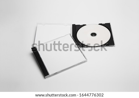 Open and close compact plastic disc box case set with white isolated blank for branding design. CD jewel mock-up on soft gray background. DVD or CD disc Сток-фото ©