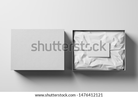 Open and closed white realistic cardboard box with brown paper and a business card on a light background. Business gift concept. Mock up. Top view. 3d rendering Stock photo ©