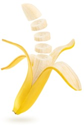 open and sliced banana floating isolated on white