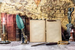 open antique book on which a magnifying glass rests. are found on a wooden desk on leather. Two lighted lanterns are incorporated to illuminate with a candle and two other writing pens