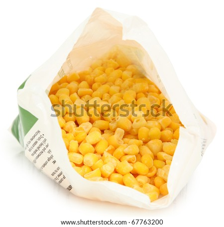Open bag of uncooked frozen corn niblet over white with clipping path.