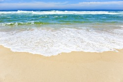 Open beach on a tropical island with waves breaking