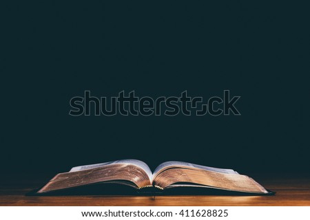 Open bible and black background