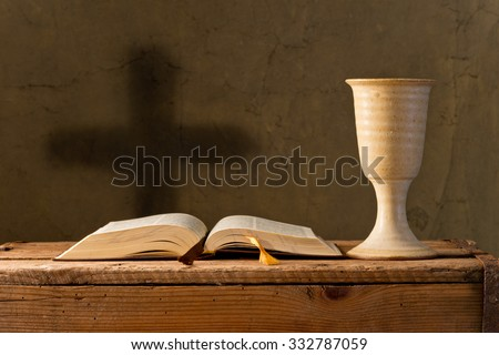 open bible with chalice of wine in the church