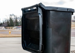 open black garbage can bins for trash and recycling
