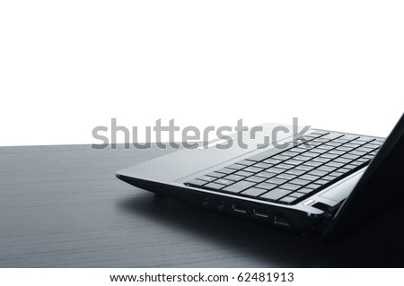 Open black laptop computer, isolated on white background.