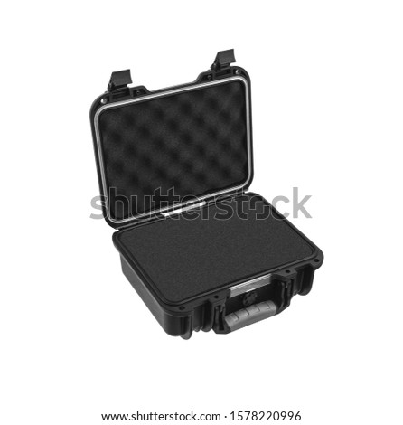 Open black plastic case with foam inside. Black plastic hard case for transporting and storing weapons. Gun container isolate on a white background.