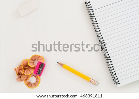 Open blank diary with yellow pencil and pencil shavings #468391811