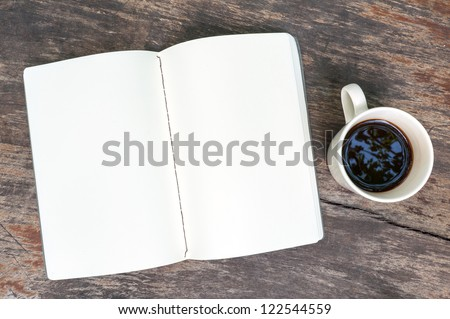 Open blank note book with coffee cup on grunge wood