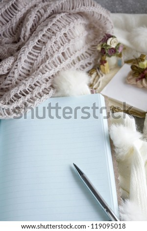 open blank note book with pen for writing
