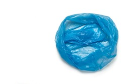 Open blue trash bag on an isolated white background. The concept of cleaning, garbage removal. Flat lay, top view